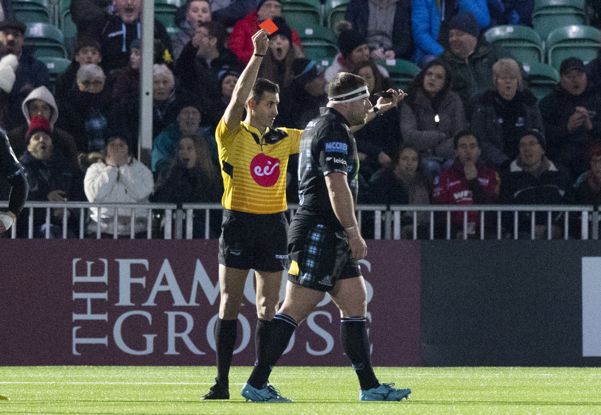 Referee Frank Murphy s ends off Alex Allan in last weekend's game at Scotstoun.