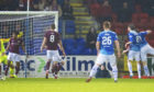 St Johnstone's Blair Alston (right) strikes to level things for the hosts.