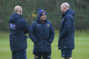 Edinburgh head coach Richard Cockerill (centre) plots Edinburgh's training with assistants Duncan Hodge and Alasdair Strokosch.