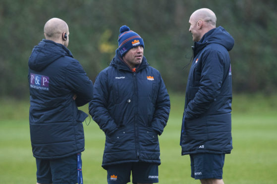Edinburgh head coach Richard Cockerill (centre) plots Edinburgh's training with assistants Duncan Hodge and Alasdair Strokosch.