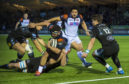 Stuart McInally spins out of a tackle to score Edinburgh's try in their 16-8 win over Glasgow at Scotstoun.