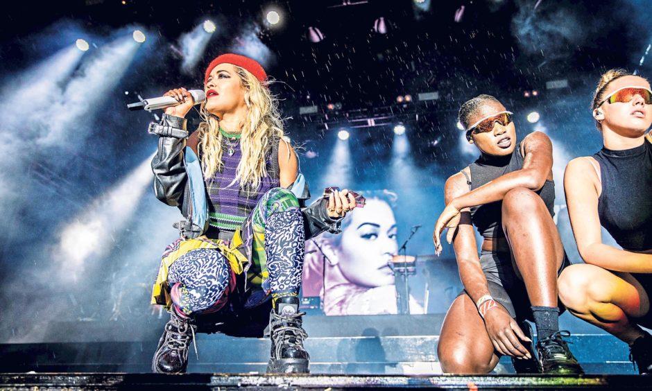 Rita Ora entertained despite the heavy rain. Steven Brown/DCT Media