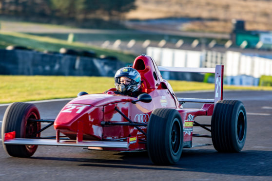 Gayle roars around the race track at Knockhill in a Formula Race Car.