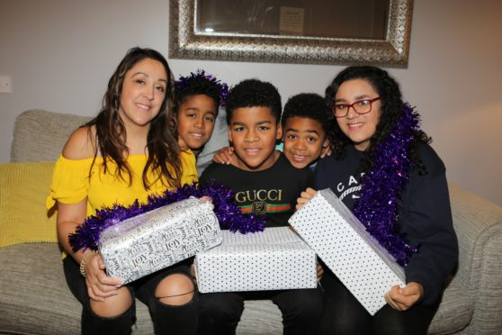 Donna Sangmor with her children Noah (9), Jay(11), Daniel(5) and Anisha(14) with the boxes they have made up for homeless people.