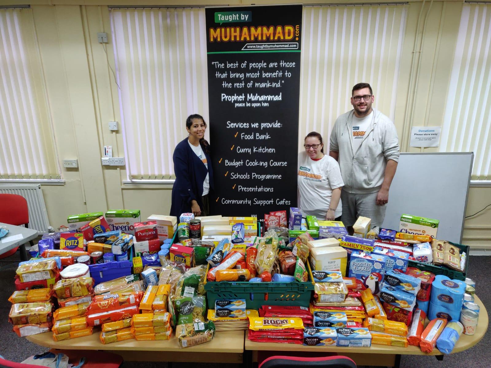 TBM's Amna Nawaz-Ali with volunteers Claire Leslie and Kairne Leslie alongside the 260kg of food