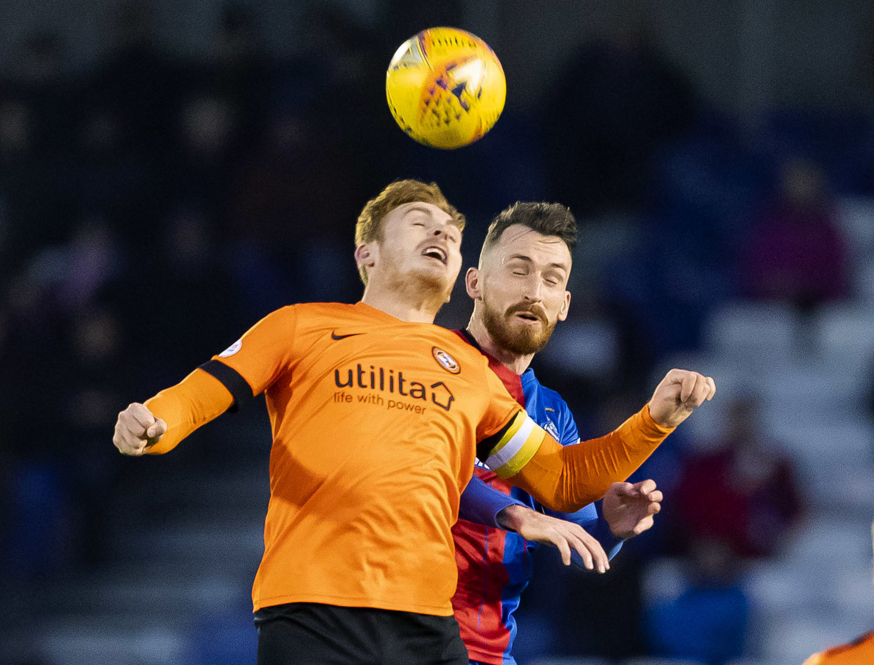 Dundee United captain Fraser Fyvie and Inverness's  Joe Chalmers compete for a header.