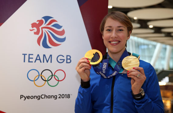 Lizzy Yarnold with her two Olympic golds.