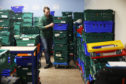 Dundee Foodbank stock coordinator Michael Calder sorting donations.