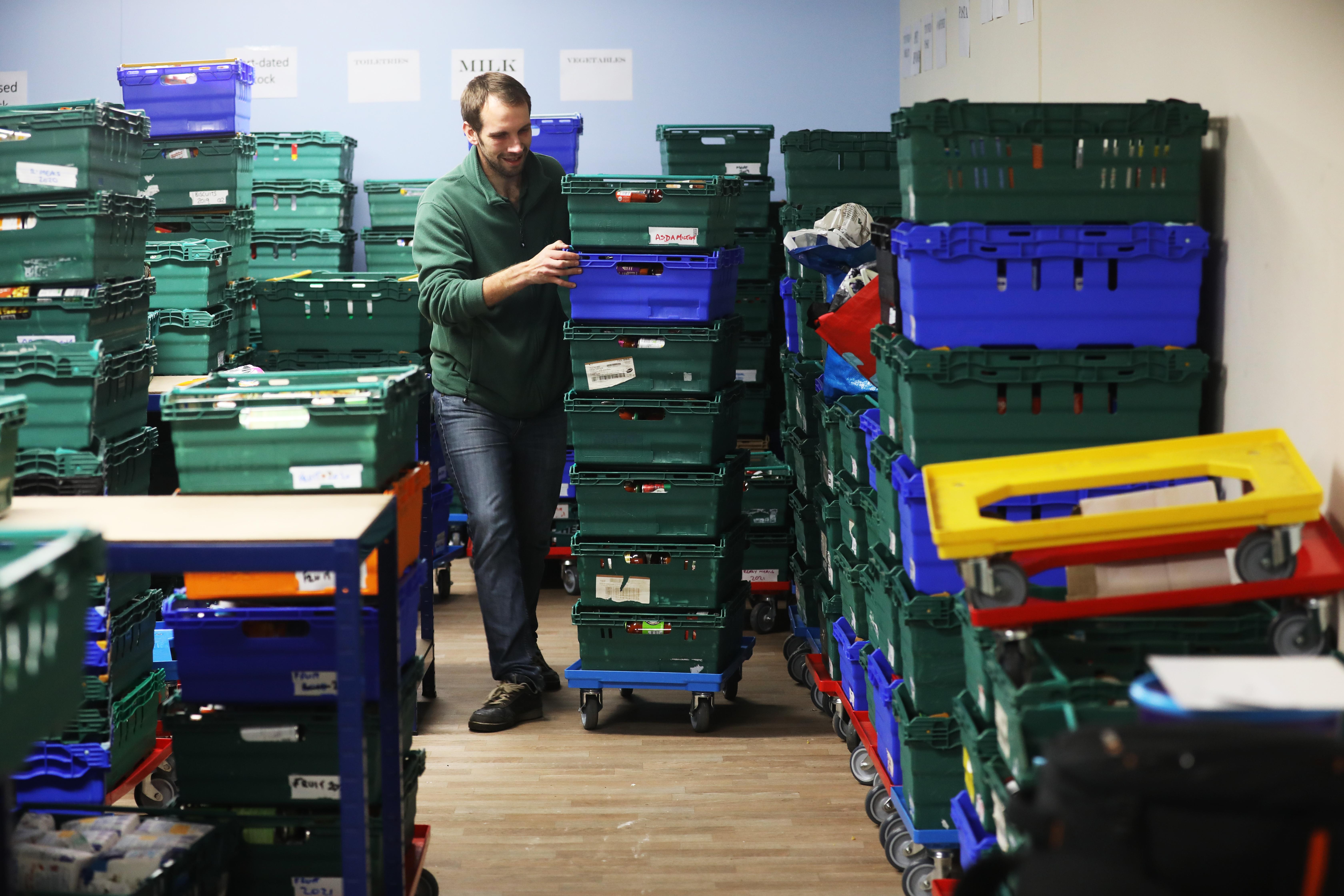 Dundee Foodbank stock coordinator Michael Calder sorting donations.