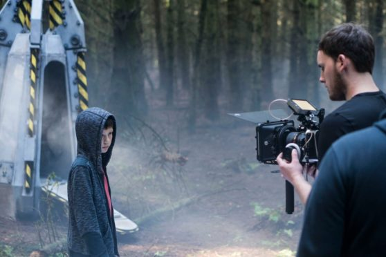 A scene from the alien invasion movie shot at Ethie Woods in Angus.