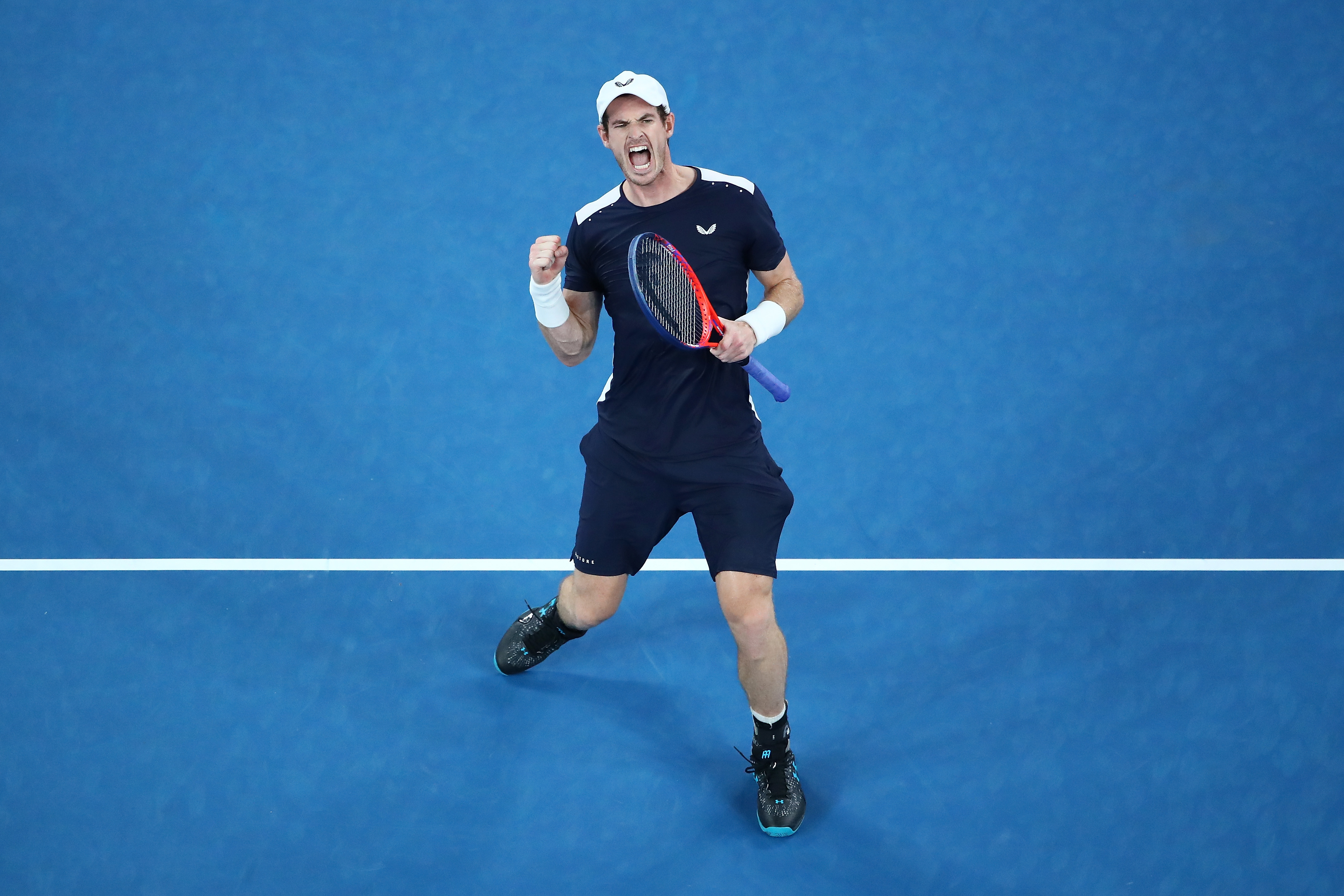 The crowd are on their feet and Murray's fist is in the air as he takes the third set.