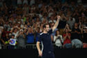 Andy Murray thanks the crowd after losing his first round match against Roberto Bautista Agut of Spain.