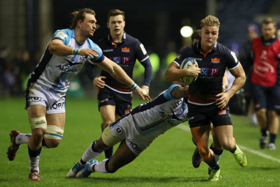 Duhan van der Merwe makes ground through defenders in Edinburgh's victory over Montpellier.