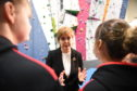 First Minister Nicola Sturgeon talks with eleven-year-old Holly Holmes from Boness during a visit to The Academy of Sport and Wellbeing, Perth College, in January 2019.