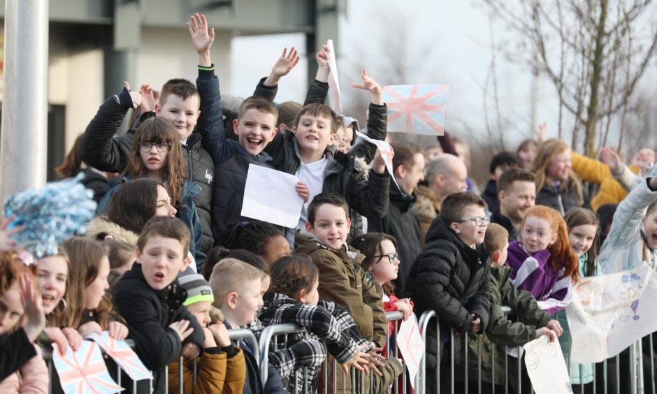Children wait for the royal couple to leave the V&A. Mhairi Edwards / DCT Media