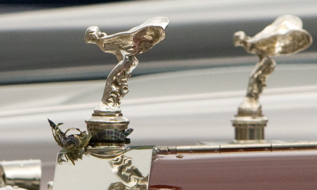 The Spirit of Ecstasy, found on Rolls-Royce vehicles.