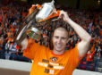 Sean Dillon raises the Scottish Cup in 2010.
