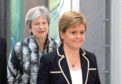 Prime Minister Theresa May and First Minister Nicola Sturgeon might both have to battle to keep their positions in 2019, says Jenny Hjul.
