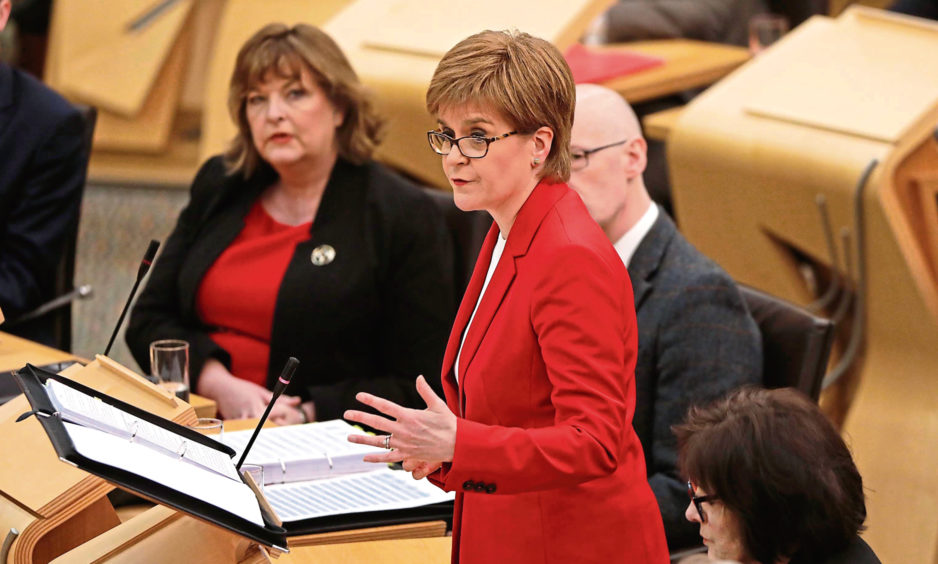 First Ministe, Nicola Sturgeon answers questions from party leaders during the final First Minister's Questions of 2018.