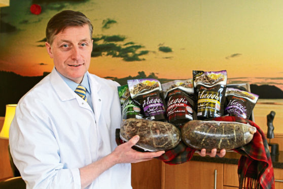 Perthshire butcher Simon Howie with a selection of haggis products.