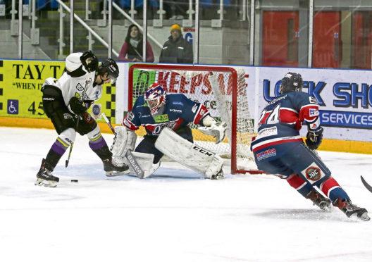 Dundee Stars goalie Pontus Sjogren saves an attempt from Manchester Storm's Logan MacMillan.