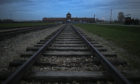 The railway track leads to the infamous 'Death Gate' at the Auschwitz II Birkenau extermination camp