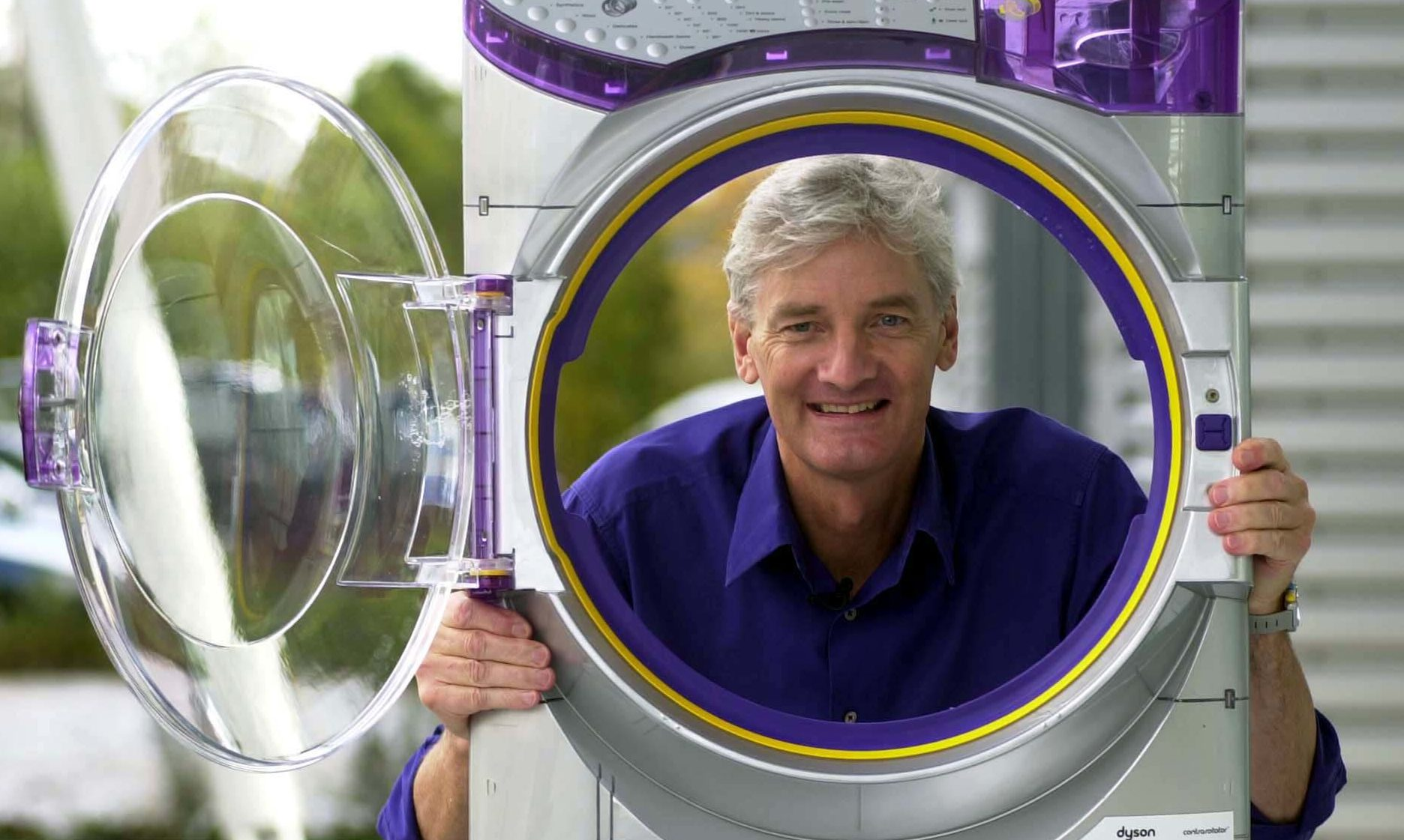 James Dyson with a Dyson Contrarotator washing machine.