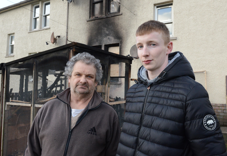 Aviary owner William Dickson (left) and neighbour Steven Bell who raised the alarm