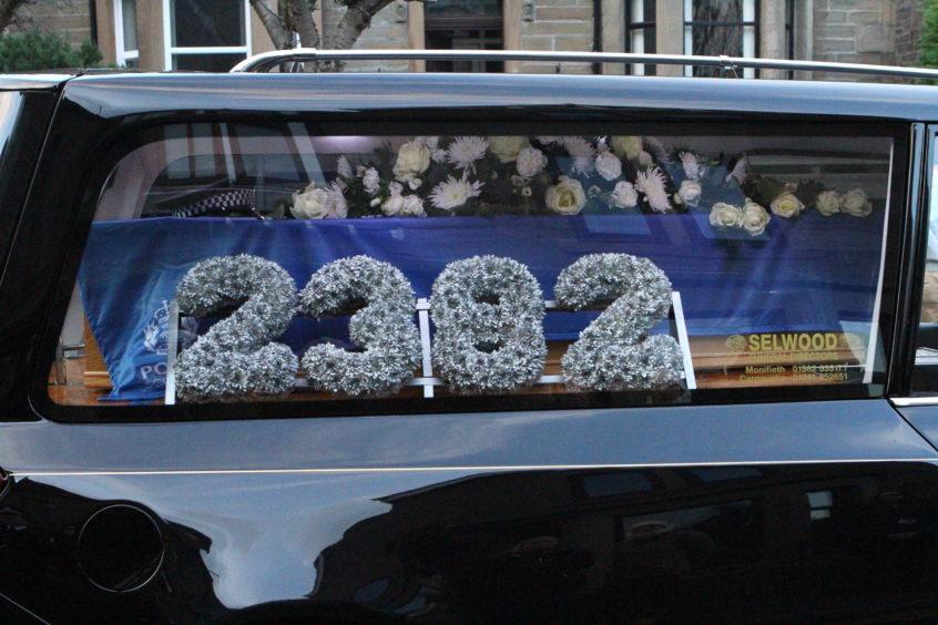 A floral tribute for Dean Morrison.