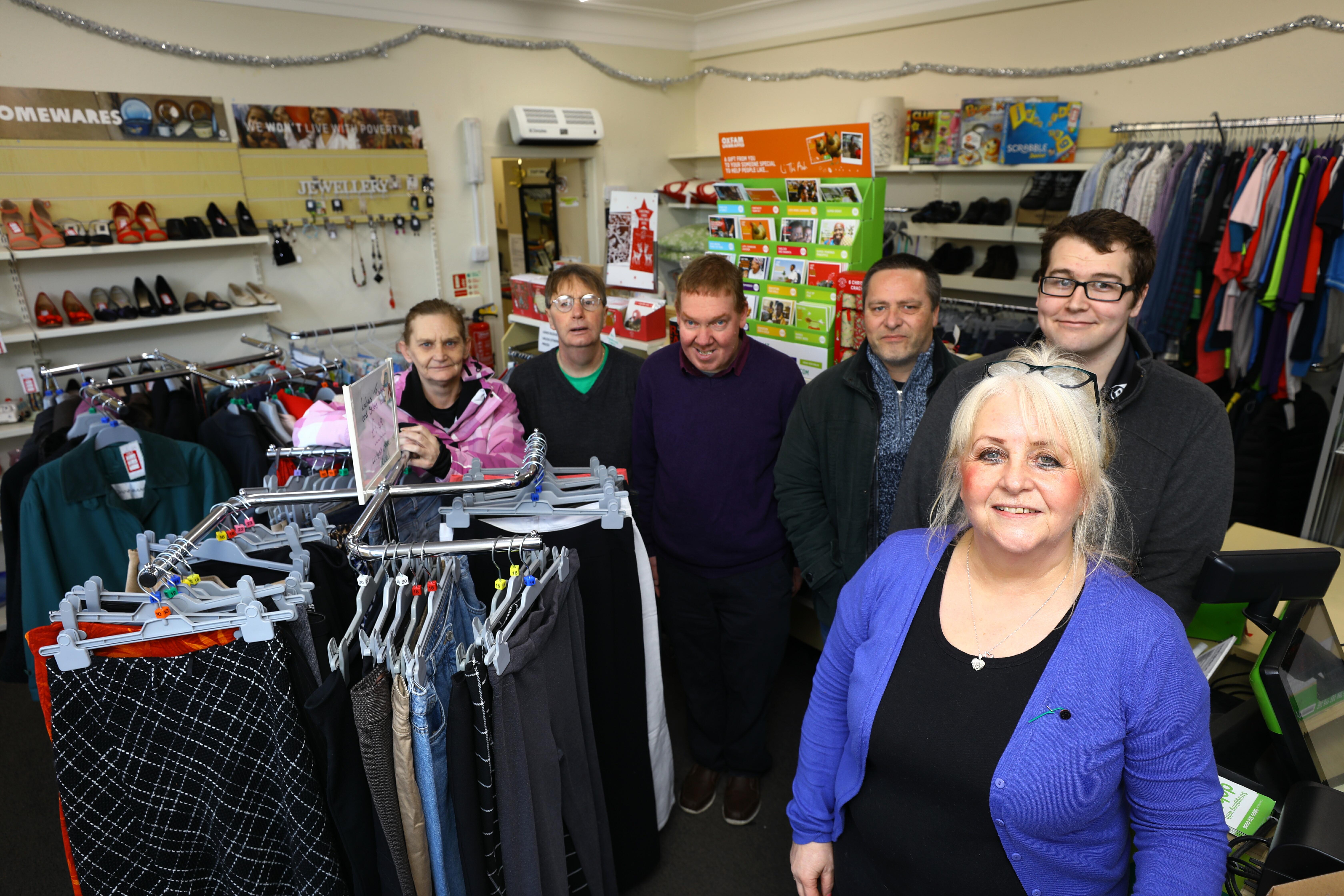 Shop Manager Lynda Stuart, front, with volunteers L/R, Wendy Bruce, Sandy Simpson, Ben Herschell, Colin Reid and Kieron Calder inside the last Oxfam shop in Angus