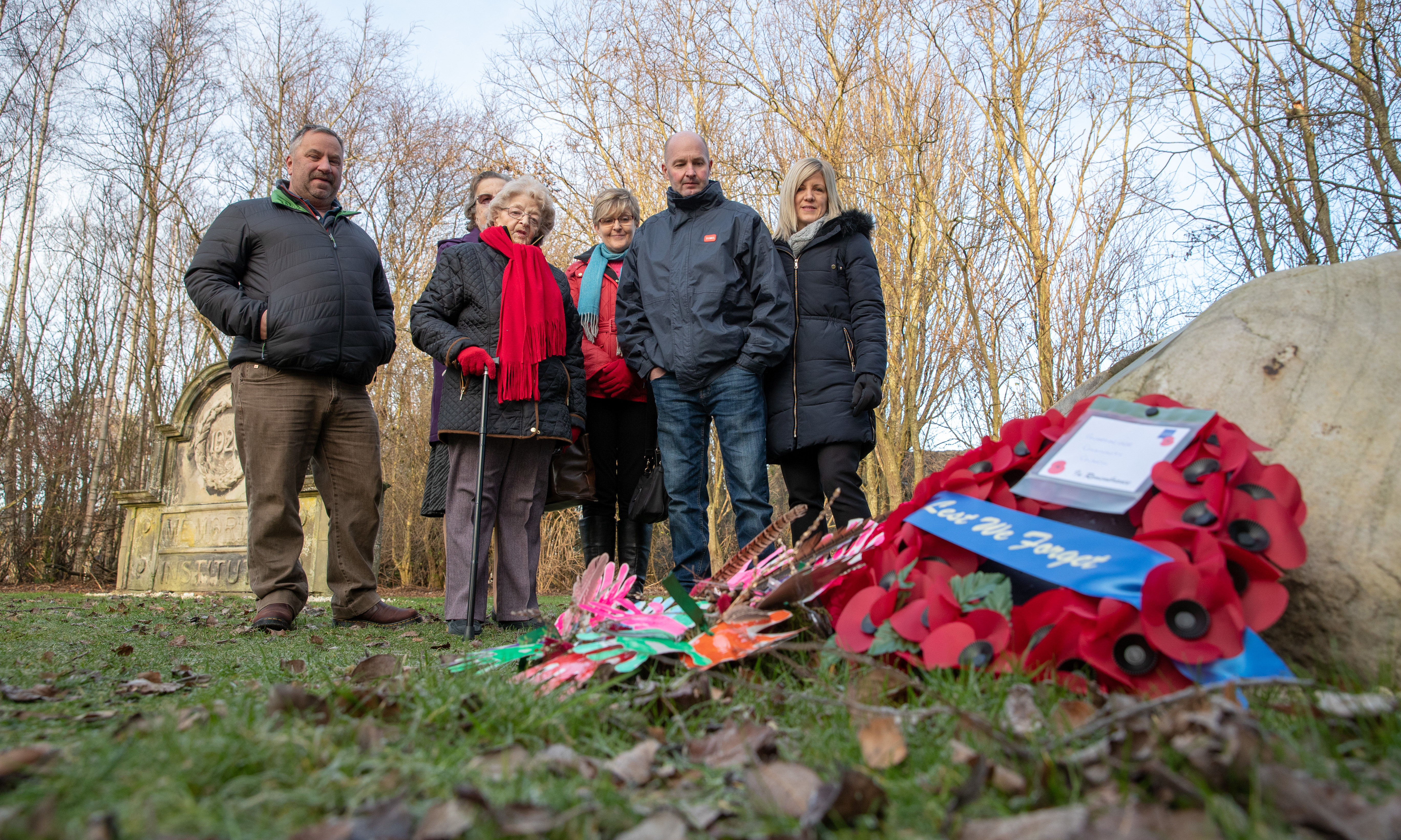 Members of the Finlay family gather to admire the memorial following a Service and rededication ceremony of stone in honour of Fife VC hero David Finlay.