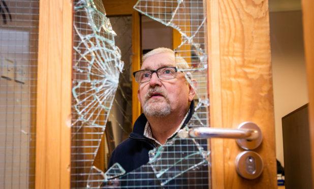 Club Secretary Jackie MacLean examines the damage