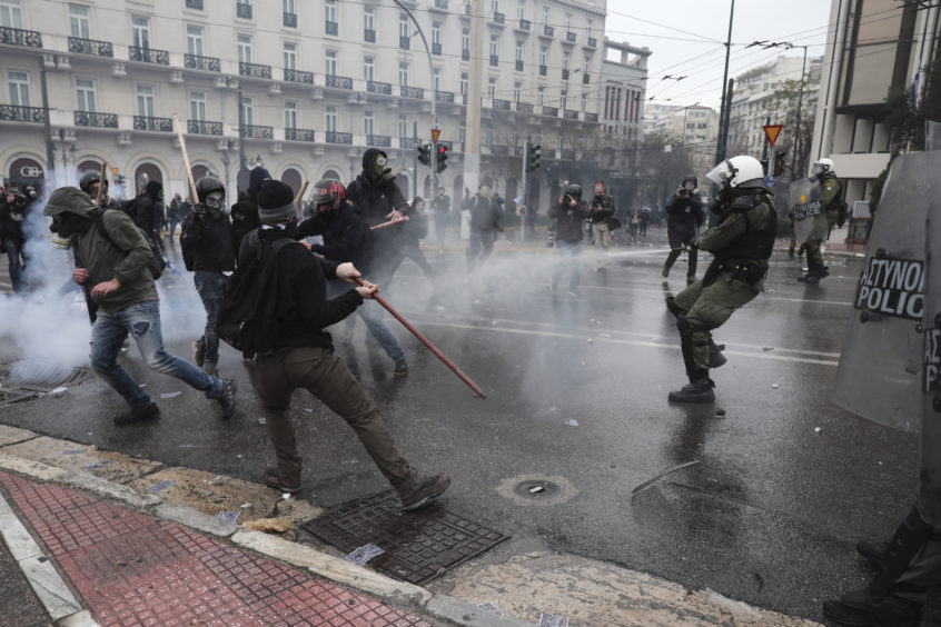 Demonstrators clash with riot police.