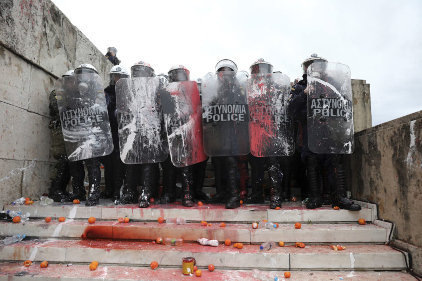 Greek riot police block the stairs leading to parliament during clashes.