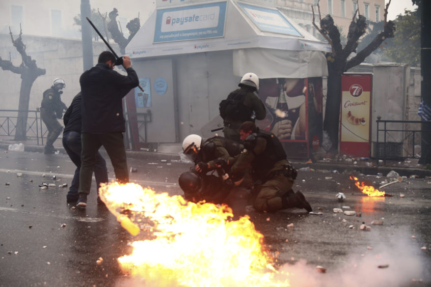 Greek riot police clash with demonstrators during a rally in Athens.