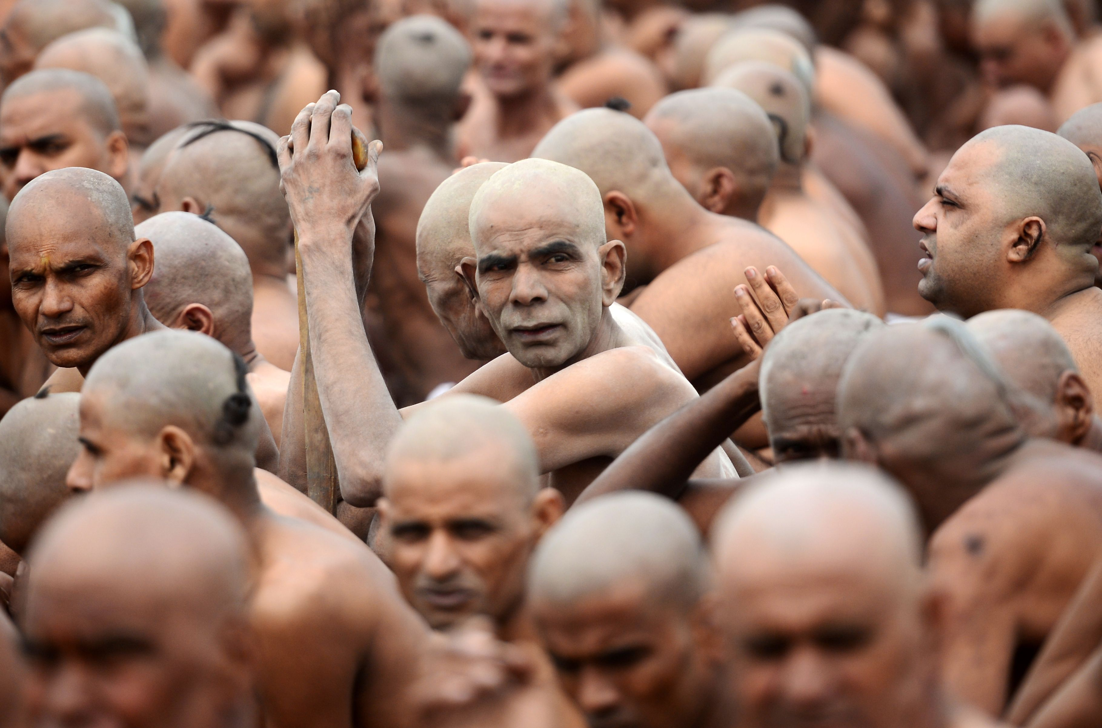 Newly initiated 'Naga Sadhus' (Hindu holy men) sit as they perform rituals on the banks of the Ganges River during the Kumbh mela festival, in Allahabad. During every Kumbh Mela, the diksha, a ritual of initiation by a guru takes place for new members.