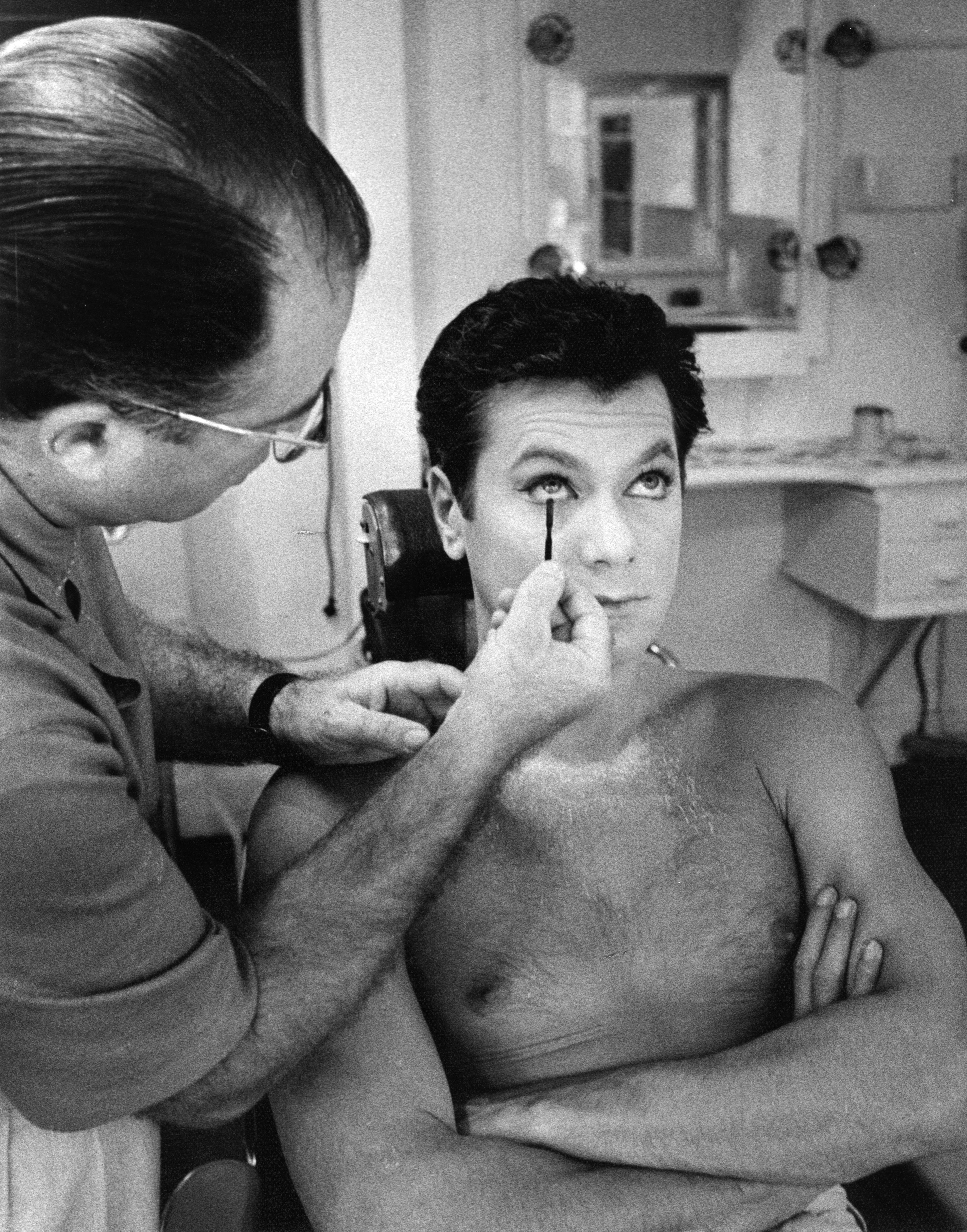 """Tony Curtis getting make up applied by Emile LaVigne on the set of """"Some Like It Hot"""" in 1958 in Los Angeles"""