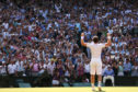 Andy Murray celebrates becoming Wimbledon champion in 2013. He was the first British winner since Fred Perry in 1936.