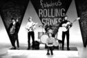The Rolling Stones during a TV performance in 1964.