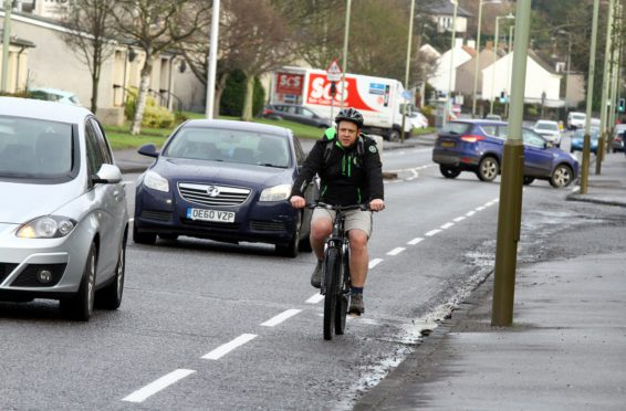 Cllr Kevin Cordell tries out the city's cycle paths.