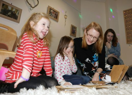 Four-year-olds Poppy Vaughan (left) and Meah Ramsay with Social Security Secretary Shirley-Anne Somerville