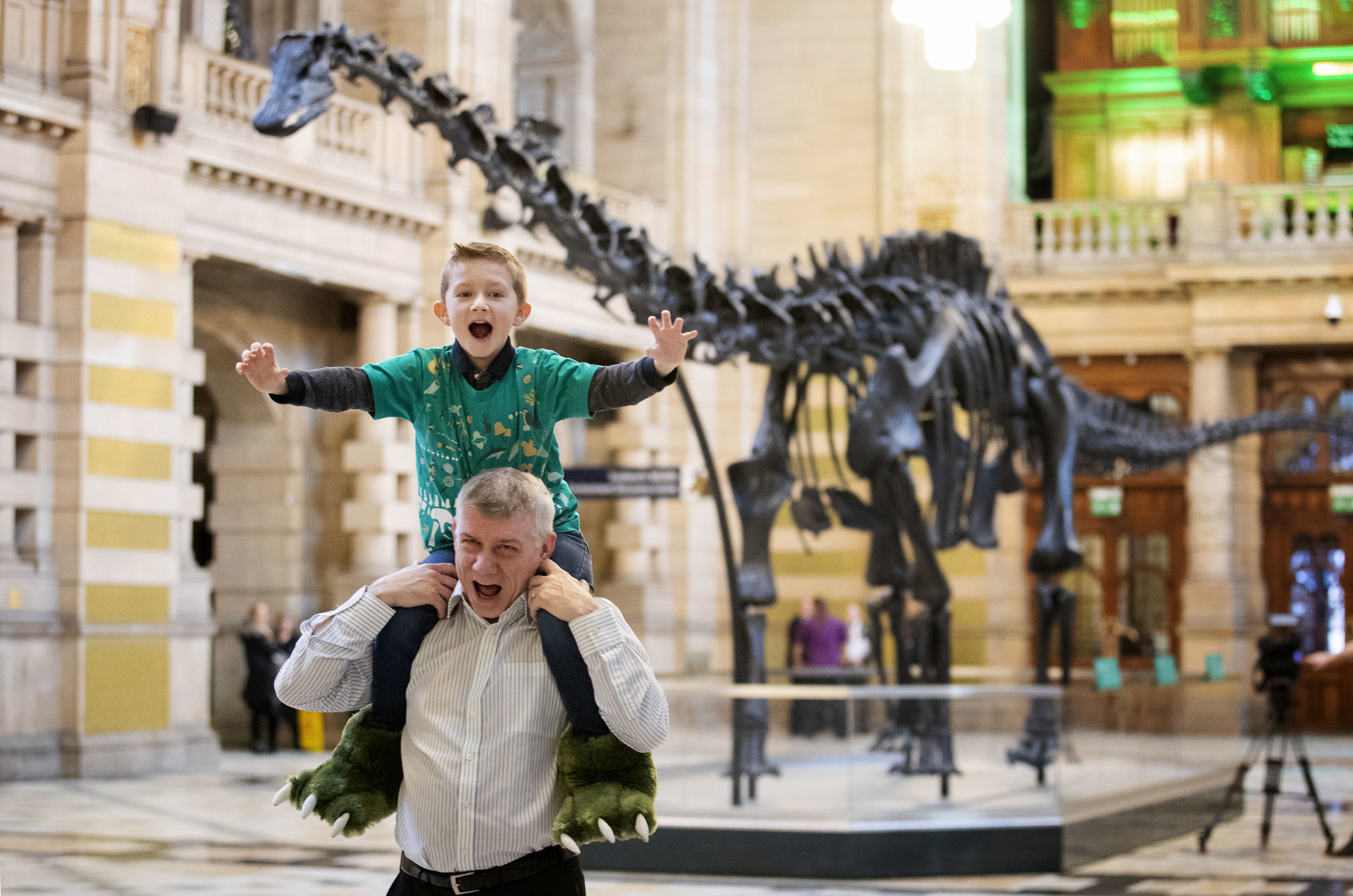 Oliver Cudden, 6, from Glasgow, with his father Andrew Cudden, was one of the first people to see Dippy, the Natural History Museum London's famous diplodocus skeleton, as it was unveiled at Kelvingrove Art Gallery and Museum in Glasgow.