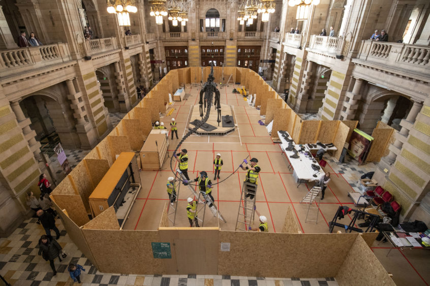 Dippy, the famous diplodocus from the Natural History Museum, is put back together after being transported to Glasgow in 16 bespoke crates, ahead of going on display in the main hall at the Kelvingrove Art Gallery and Museum.