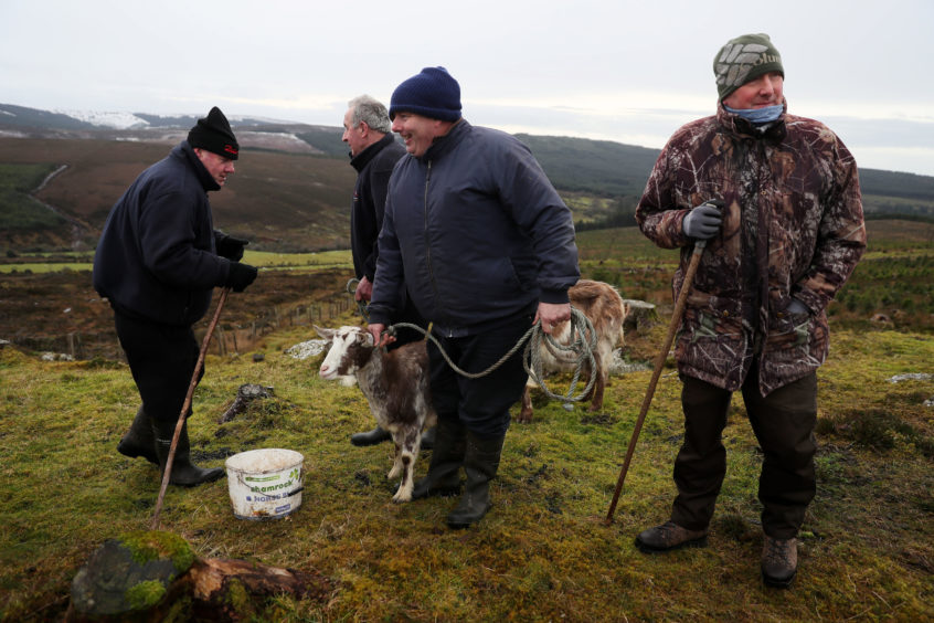 People gather on Spink Hill, Co. Offaly, for the 'Milking of the Goat' festival. The festival celebrates Imbolc which marks the beginning of spring and is one of the four Celtic seasonal festivals.