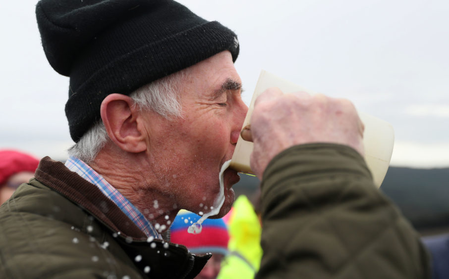 Paddy Gleeson samples the milk during the 'Milking of the Goat' festival on Spink Hill, Co. Offaly. The festival celebrates Imbolc which marks the beginning of spring and is one of the four Celtic seasonal festivals.