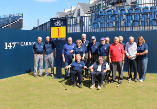 The Golf Memories Carnoustie Group on the 1st tee of the Championship Course ahead of The 147th Open