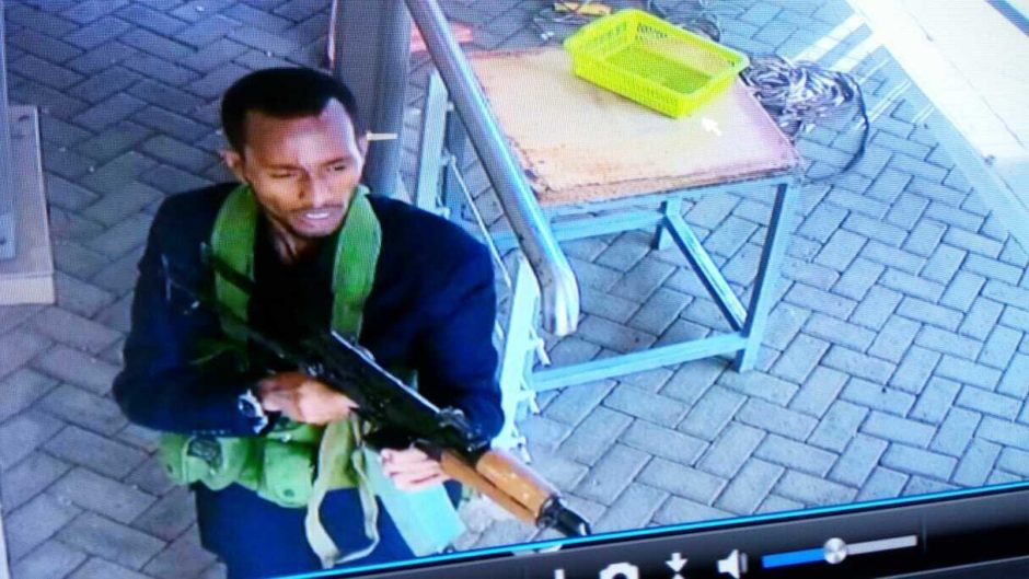 "In this grab taken from security camera footage released to the local media, an armed attacker walks in the compound of a hotel, in Nairobi, Kenya.Extremists launched an attack on a luxury hotel in Kenya's capital, sending people fleeing in panic as explosions and heavy gunfire reverberate through the neighborhood. A police officer says he saw bodies, ""but there was no time to count the dead."" Al-Shabab the Somalia-based extremist group is claiming responsibility."