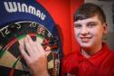 Nathan is gunning for world darts glory.