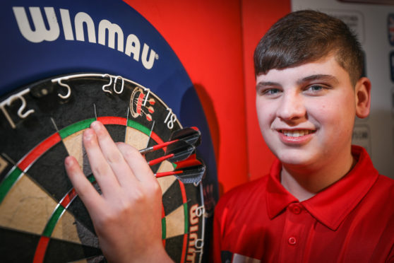 Nathan is gunning for world darts glory.