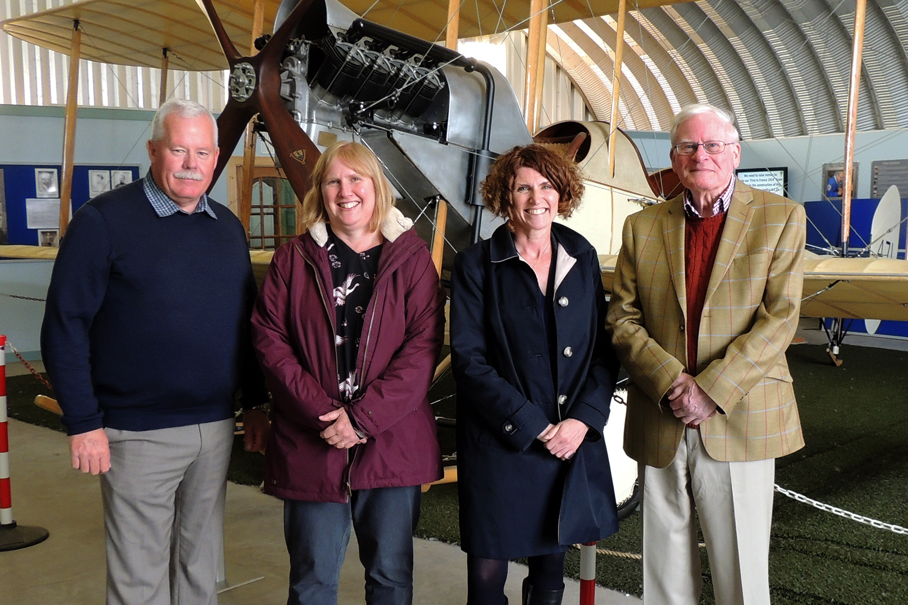 With the replica BE2 aircraft at a recent visit to Montrose Air Station (from left) MASHC chairman Ron Morris, Claire Carr RAF Museum Cosford, Maggie Appleton CEO RAF Museum and Alan Doe MASHC.   Picture: Neil Werninck